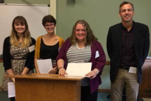 "Presenters Emily Bryce Swain, Rebecca Gonner, and Haley Helgesen stand with Dr. Helwig after presenting their panel ""Transatlantic Women: Overcoming Patriarchal Obstacles"" at the local conference"